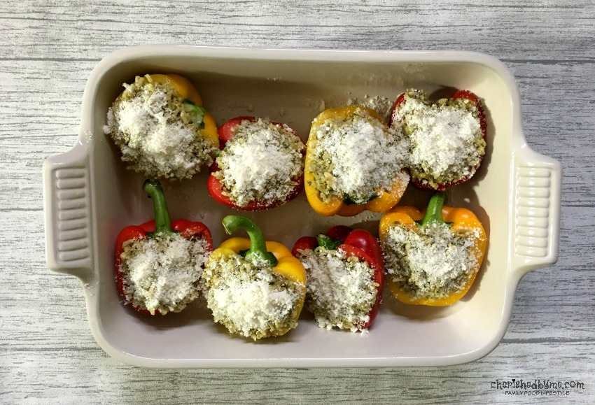 Sprinkle with cheese before popping in the oven - Pesto & Pine Nut Rice Stuffed Peppers cherishedbyme.com